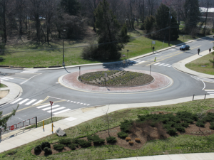 Small low speed single lane roundabout in a suburban setting.