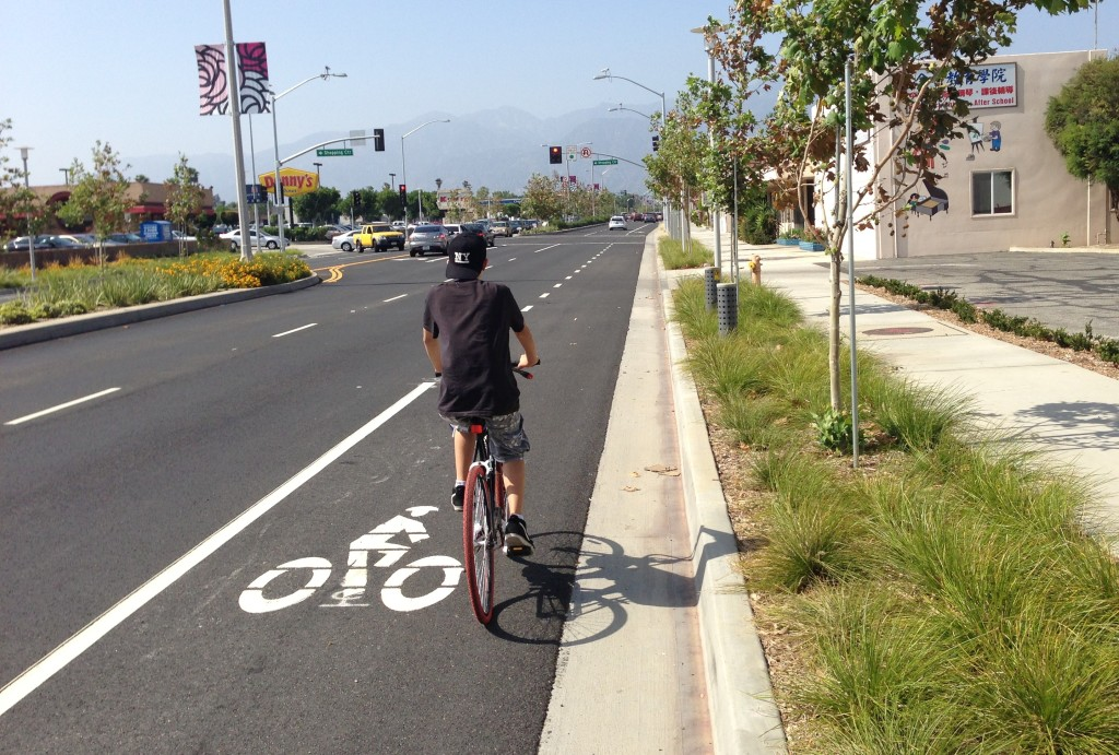 As opposed to a STROAD a Boulevard is a more walkable, pleasant, attractive and higher value roadway.